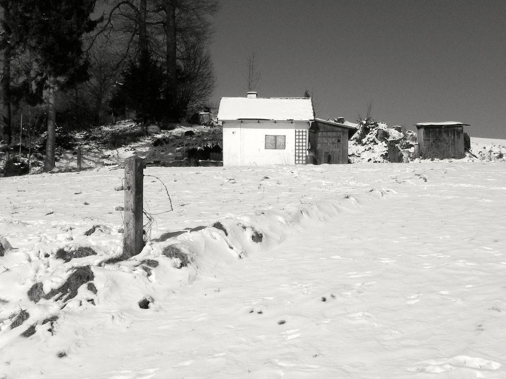 white hut in snow.jpg