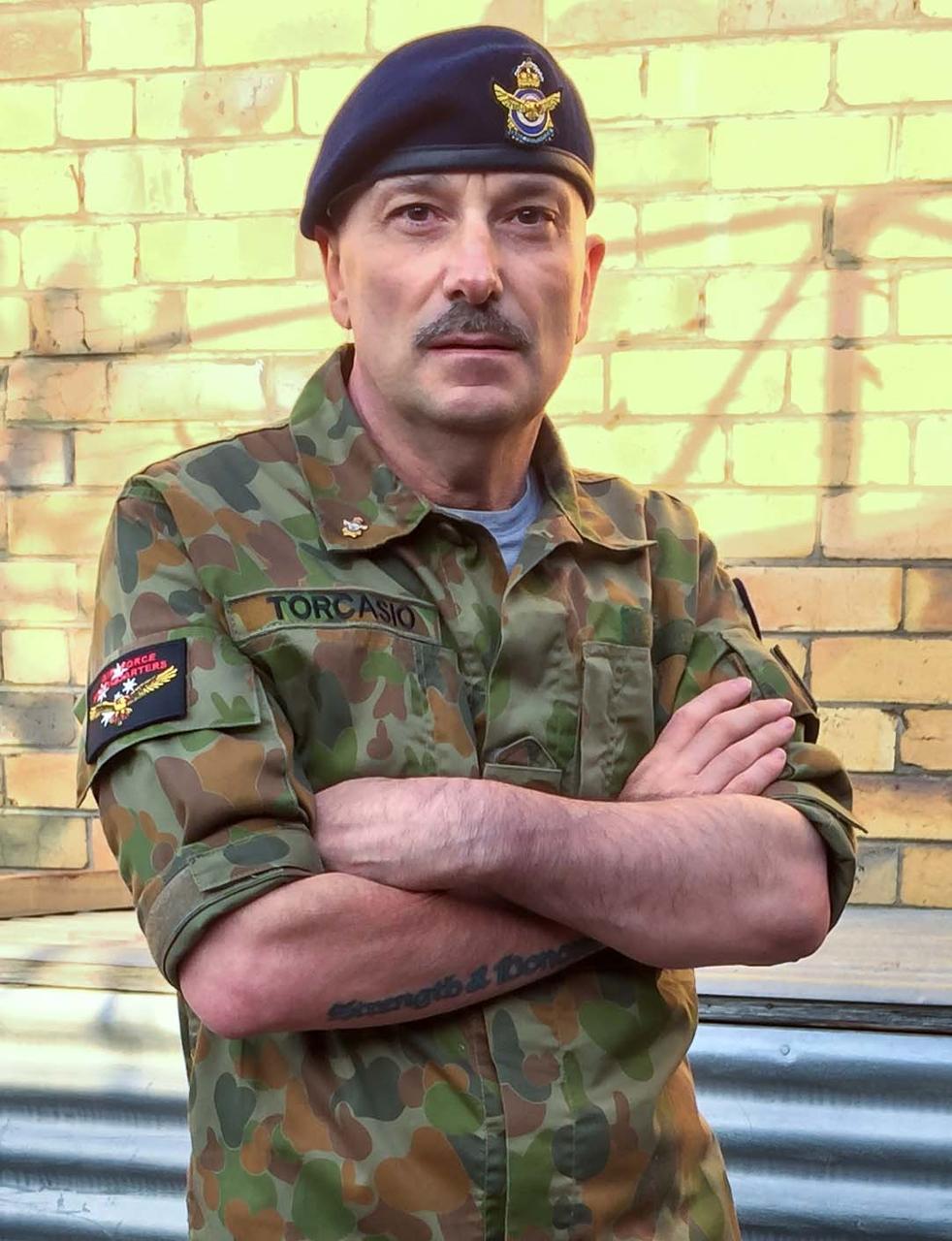 John Torcasio: Wearing Camouflage Uniform